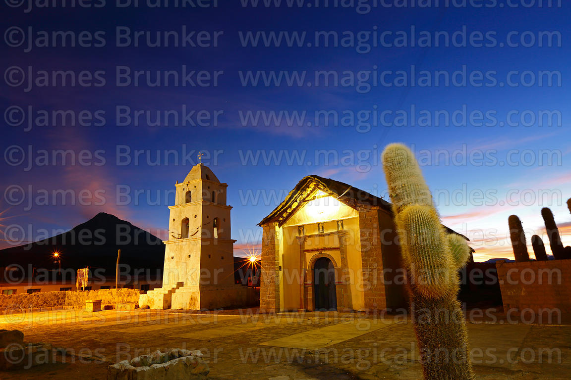 Rustic church, belfry, Echinopsis cactus and village square at sunset, Cariquima, Region I, Chile
