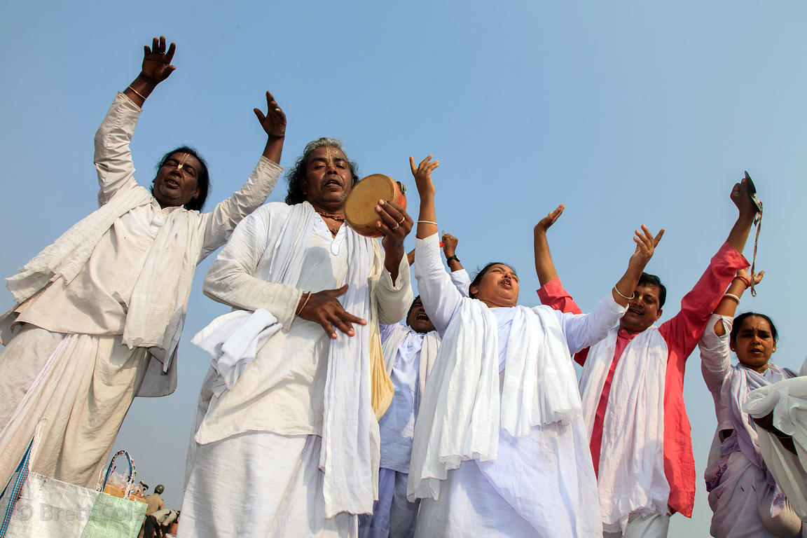 Pilgrims in white pray on the beach at the Gangasagar Mela (festival), a pilgrimage to Sagar Island in India, where the Gange...