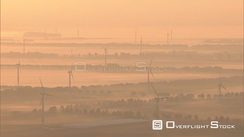 Wind turbines in an amber haze on the Flevopolder, The Netherlands