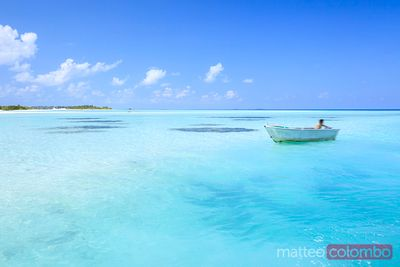 Wooden fisherman boat in the blue ocean, Maldives