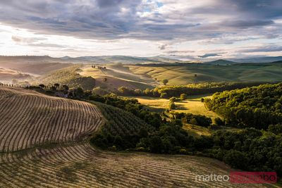 Aerial sunrise over countryside, Val d'Orcia, Tuscany, Italy