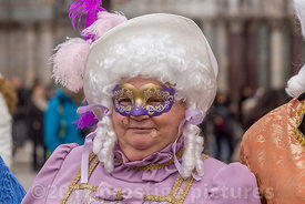 Older woman in St Mark's Square in period costume and a white wig