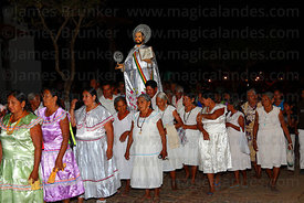 Abadesas accompany figure of San Ignacio from church to Mojeño Cabildo (parliament) building at start of festival, San Ignaci...