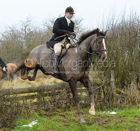 Jamie Collie jumping the hunt jump at Newbold - The Fitzwilliam Hunt visit the Cottesmore at Burrough House