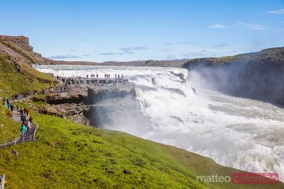 Famous Gullfoss waterfall with people visiting, Iceland