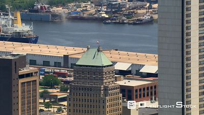 Close flight past skyscrapers near waterfront in Mobile, Alabama.