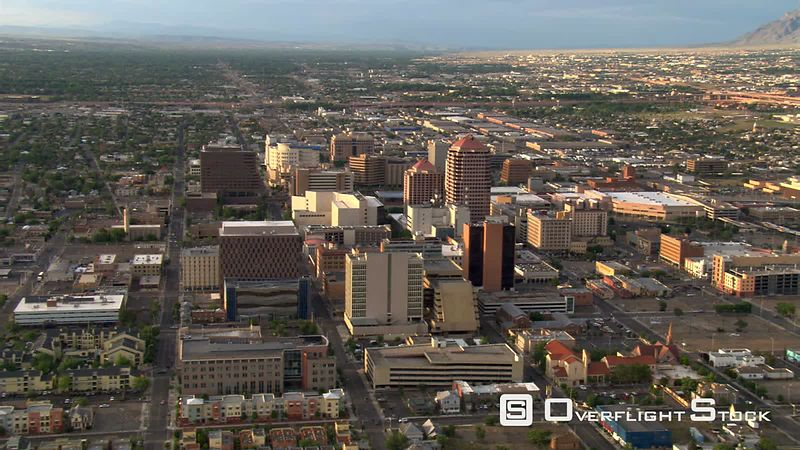 Wide orbit of Albuquerque with Sandia Mountains behind cityscape.