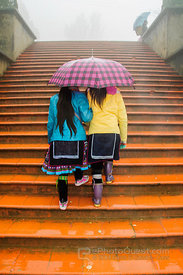 Two Black Hmong Girls on Stairs