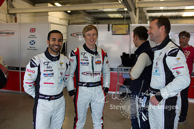 Race winners Ahmad Al Harthy and Michael Caine, in the pit lane pre-race with Rory Butcher and the Oman Racing Team, at the S...