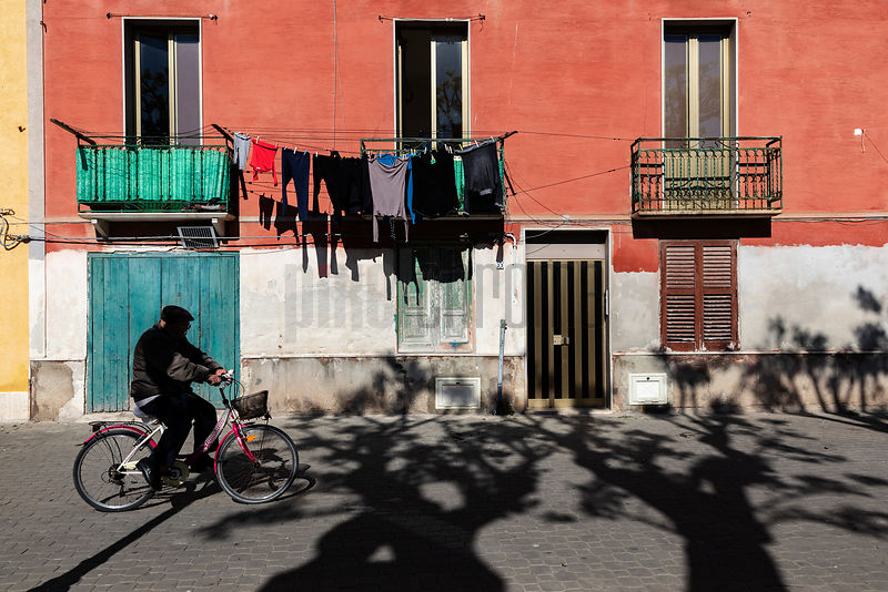 Man Riding a Bike in the Streets of Trapani