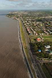 Aerial view of the sea wall protecting Georgetown, a city built below sea level, Guyana, December 2009