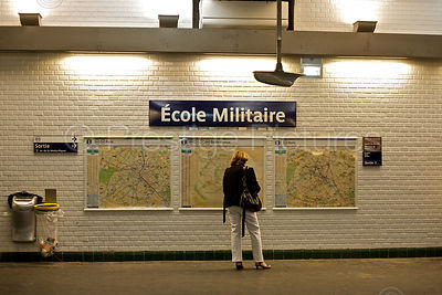 Woman Reads the May in the Ecole Militaire Metro Station