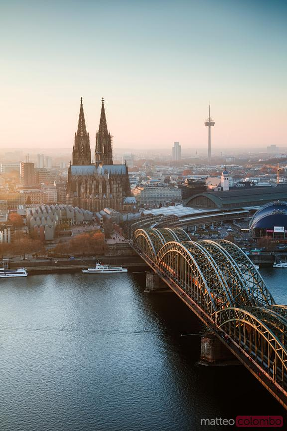Cologne cathedral and bridge at sunset, Germany