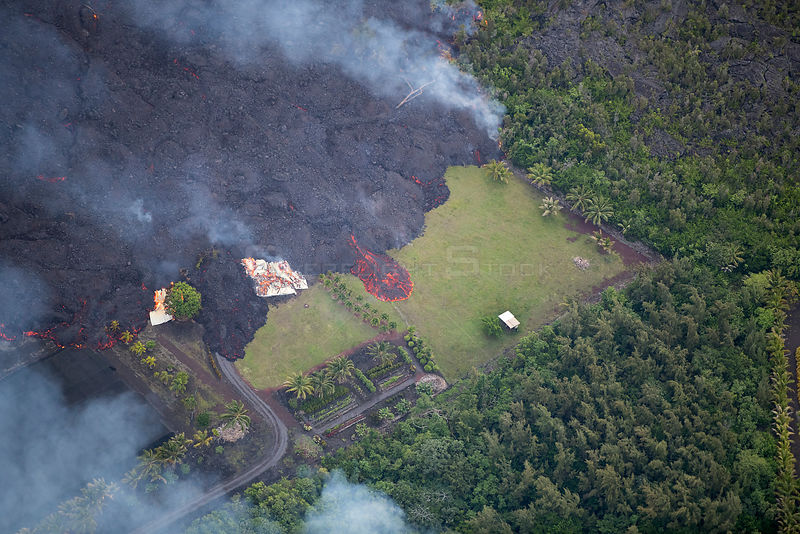 Lava originating from Kilauea Volcano, erupting from fissure 8, near Pahoa,  flowing through lower Puna into Kapoho, destroyi...