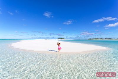 Woman on tropical beach Honeymoon Island, Cook Islands