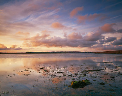 A soft pink dawn sky at Hurst reflected in fairly high tide producing a tranquil and idyllic Ensglish summer scene. The white...