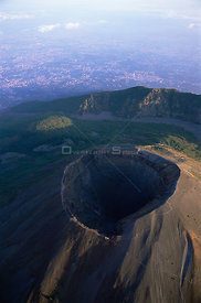 Aerail view of crater of Mount Vesuvius with Naples in the background, Southern Italy.
