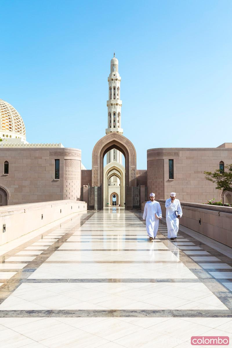 Oman, Muscat. Sultan Qaboos Grand Mosque with arabic men