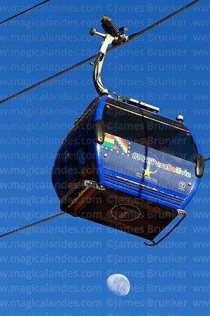 Cable car cabin with Mar para Bolivia / Sea for Bolivia slogan on it and almost last quarter waning moon, La Paz, Bolivia