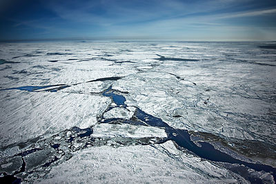Aerial view of the pack ice breaking up and melting. Iles de la Madeleine, Magdalen Island, St. Lawrence, Canadian Arctic. Ma...