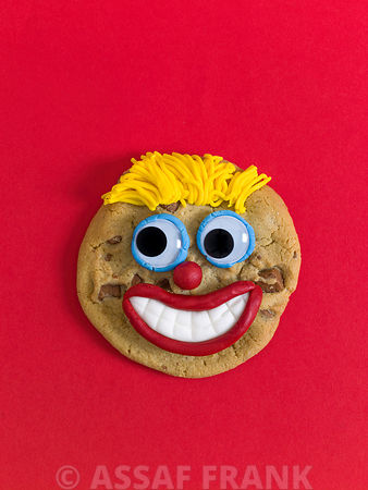 Face shaped biscuits on Red background