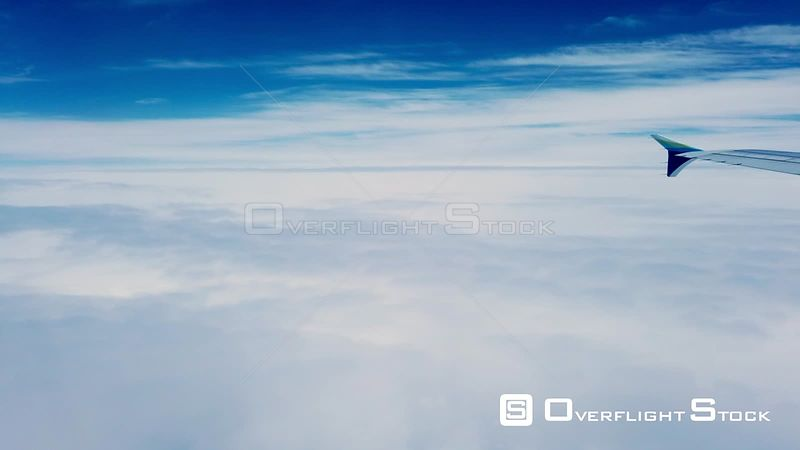 Passing Above Clouds With Winglet Tip In View On Commercial Airline Washington State
