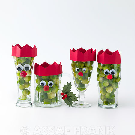 Santa face on glasses filled with brussel sprouts