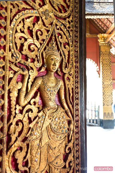 Laos, Luang Prabang.  Decoration on a door of a temple