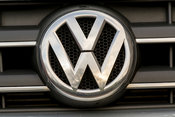 Volkswagen badge on front of car grille.