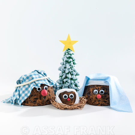 Puddings decorated in christmas theme on white background