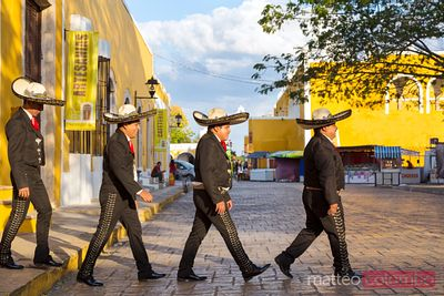 Mariachi group crossing the street in Beatles style, Mexico