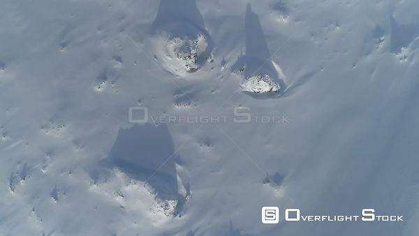 Aerial Slowly Flying Over Snow Covered Lava Field Iceland Day Long Shadows