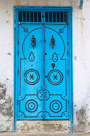 A very Tunisian sight, the highly decorated door. This example is from the Mediana of Kairouan. Kairouan, Tunisia; Portrait