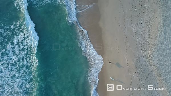 Top down view of surfers on a beach in Perth Australia