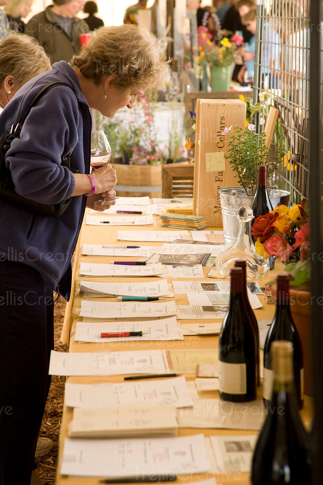A woman peruses various lots of a silent auction