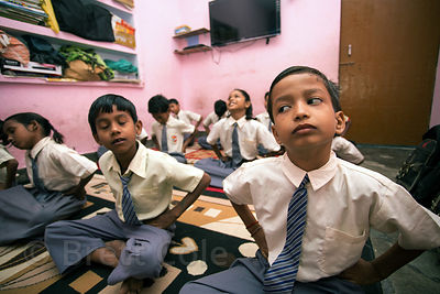 Students do yoga at a school in Varanasi, India operated by Dutch NGO Duniya (duniya.org)