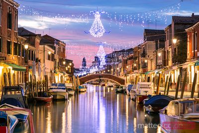 Canal at sunset with Christmas lights hanging, Burano, Venice