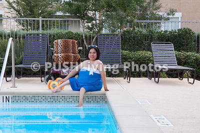 Woman using a power wheelchair swimming in a pool