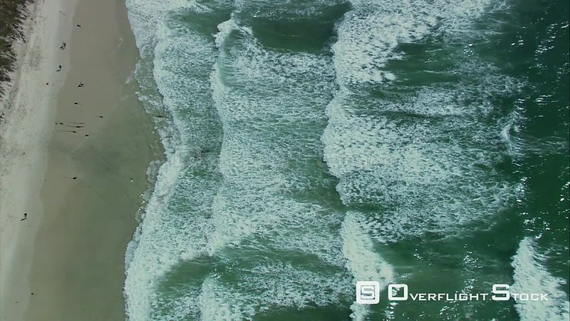 Aerial shot of waves crashing against a shoreline. Cape Town Western Cape South Africa