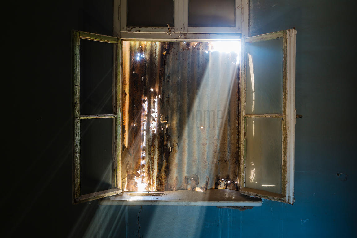 Beams of Light Entering Room in Abandoned Building