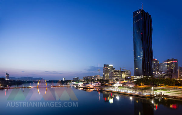 Austria, Vienna, Donau City, Danube River and DC Tower 1 in the evening