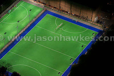 Aerial view of illuminated hockey pitches at night