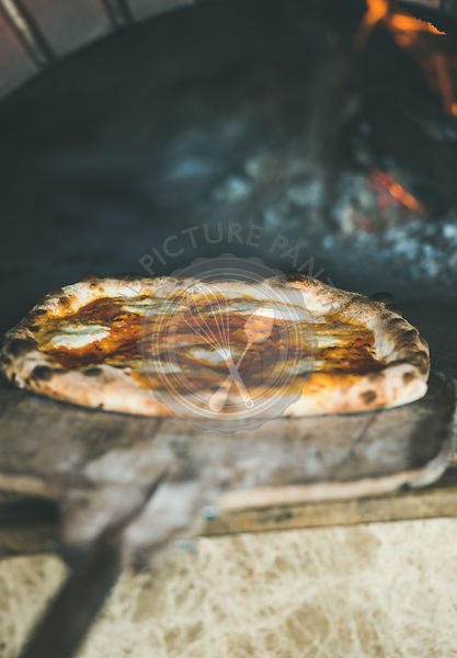 Freshly baked pizza with cheese in pizza wood ovens