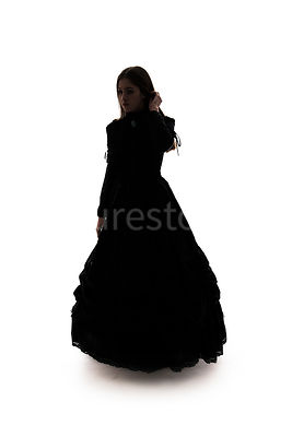 A Victorian woman, in a dress, with hair down, in silhouette – shot from eye level.