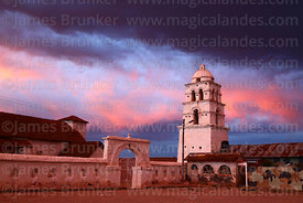 "Village square, belfry and main building of the so called ""Sistine Chapel of the Andes"" / Capilla Sixtina de los Andes at sun..."