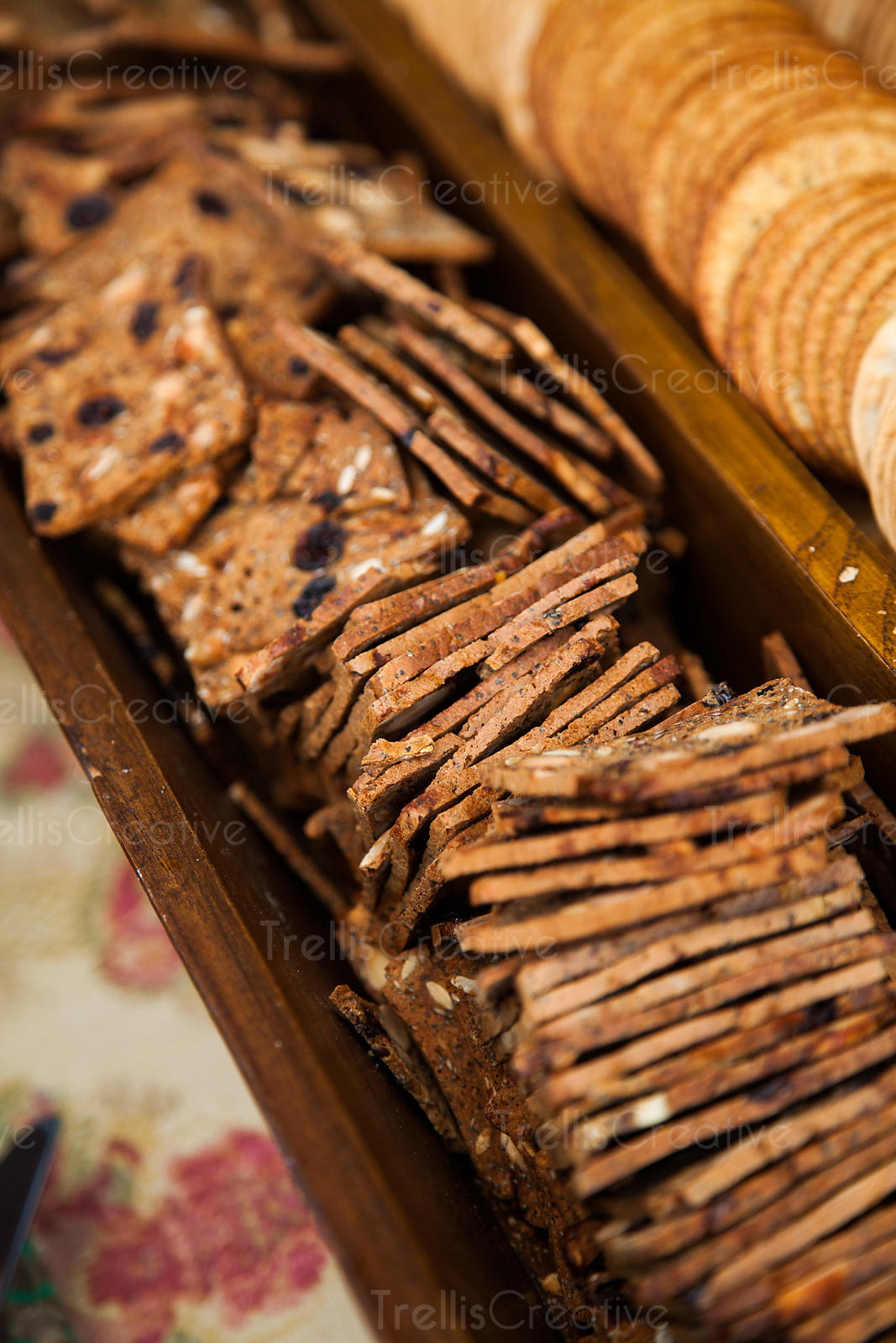 Several varieties of crackers neatly laid out for appetizers