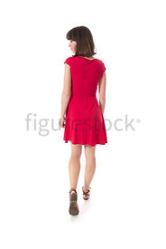 A woman in a red dress walking away – shot from eye level.