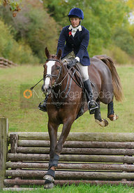 Katie Barber jumping a hunt jump at Thorpe Satchville
