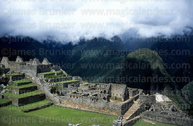 Stormy light over residential sector, Putu Cusi mountain and Urubamba Canyon, Machu Picchu, Peru