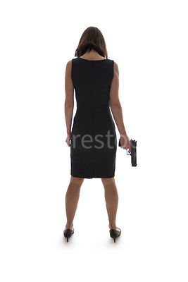 A woman, standing, holding a gun, in semi-silhouette – shot from eye level.